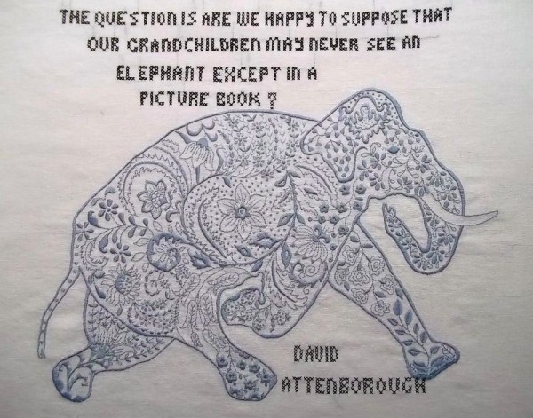 Embroidered elephant with quote said to be by David Attenborough