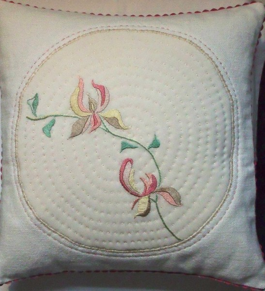 Cushion with stylised magnolia: hand embroidery
