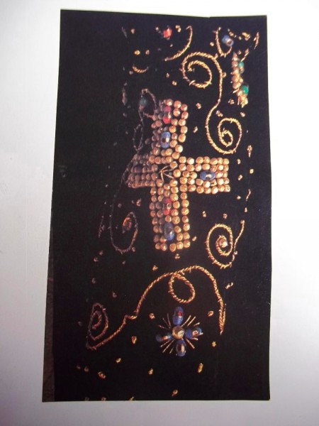 Magazine cutting showing sleeve embroidered with pearls and beads