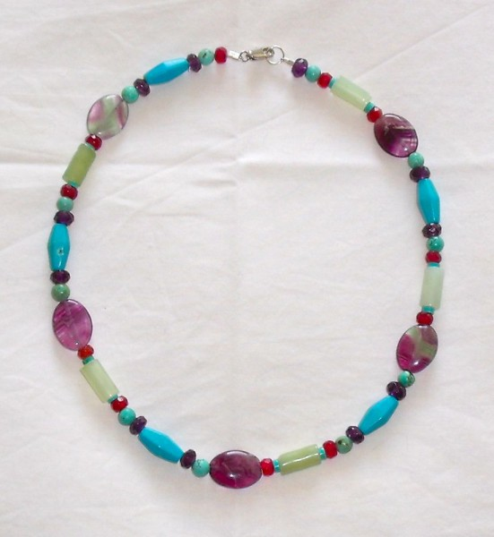 Necklace of semi-precious stones: garnet, amethyst, jade, fluorite and turquoise (or possibly howlite)