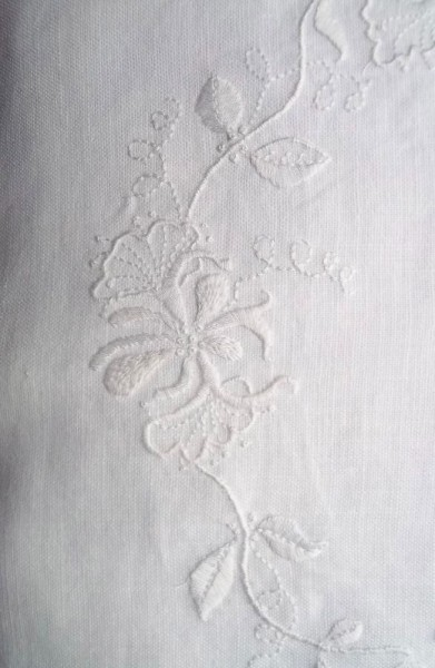 Whitework embroidered honeysuckle cushion: detail of hand embroidery