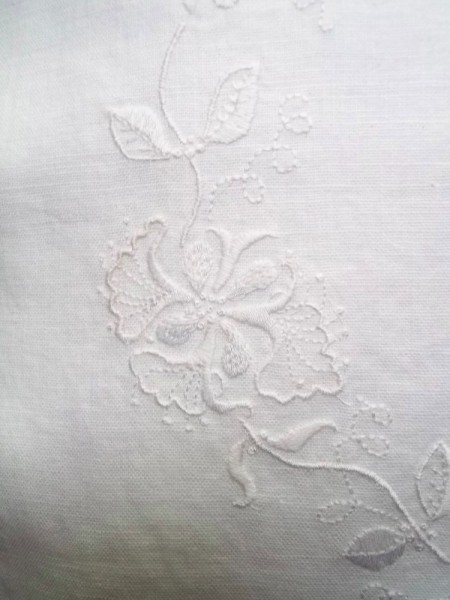 Whitework honeysuckle embroidered cushion: detail of hand embroidery