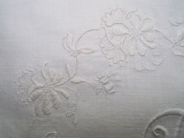 Whitework honeysuckle embroidered cushion: detail of hand embroidery with honeybee