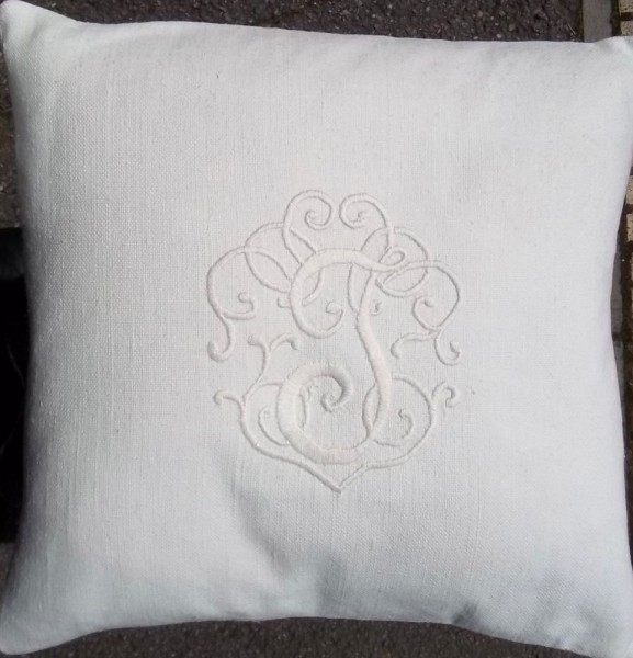 Whitework cushion with embroidered monogram