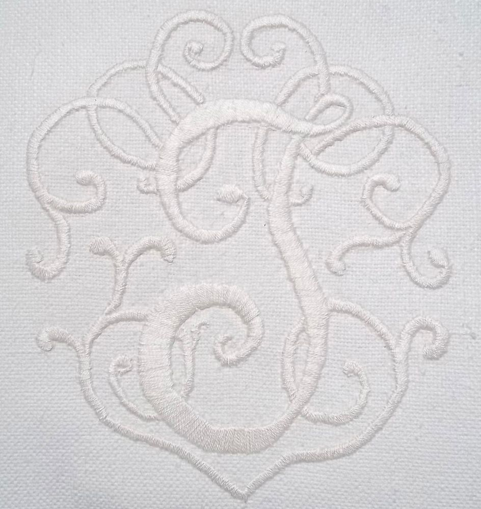 Whitework monogram 'J' hand embroidered on a linen union cushion