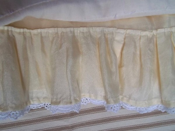 Christening dress: detailof attached petticoat with guipure lace edging.