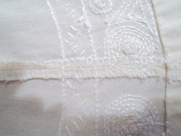 Christening dress: seam neatening with buttonhole stitch - not so neat but necessary when no sewing machine is available