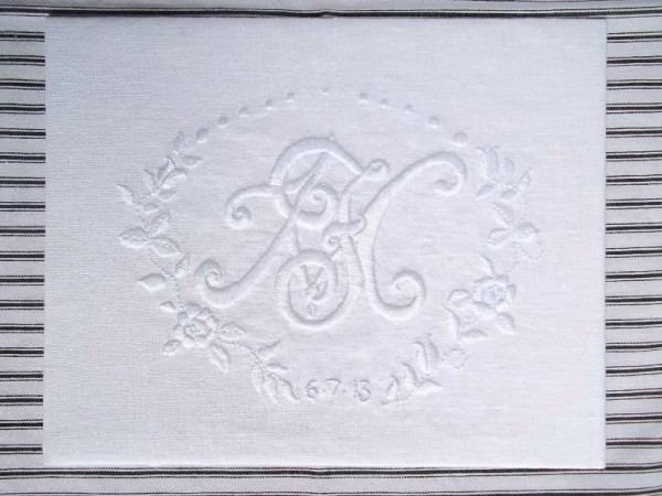 Wedding monogram: white embroidery cotton on white linen. Double monogram of F & M