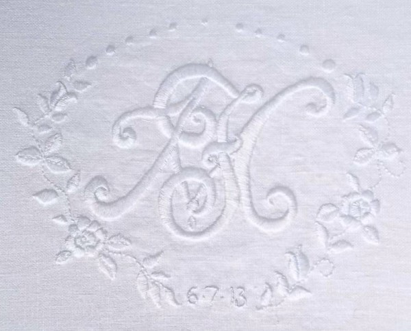 Wedding monogram: F&M hand embroidered with roses on linen