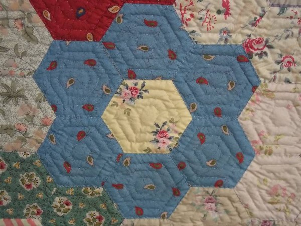 Grandmother's garden quilt: detail of hexagon patches showing Souleiado and Laura Ashley fabrics