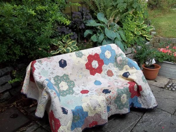 Grandmother's garden patchwork quilt (hand pieced and hand quilted)