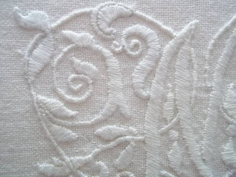 Whitework M: detail of hand embroidery in white embroidery cotton on white linen (Mary Addison)