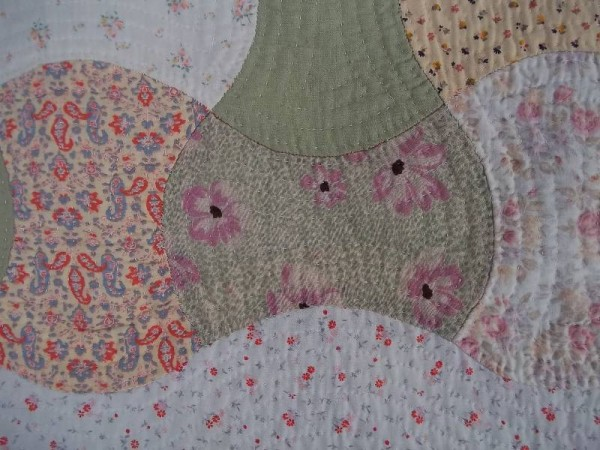 Double axehead quilt: detail showing piece in Liberty varuna, a fine wool.