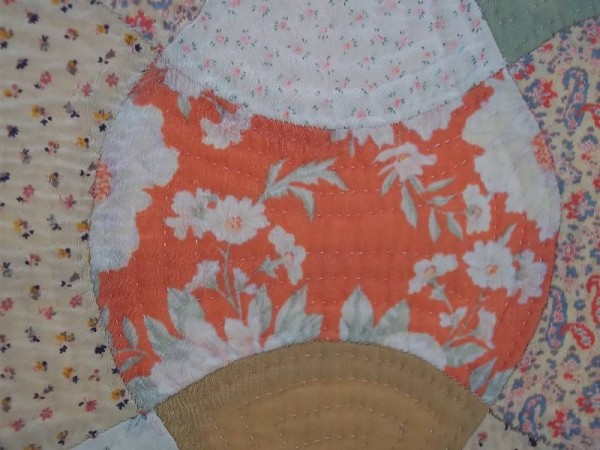 Double axehead quilt: detail of fabric piece - possibly viyella.