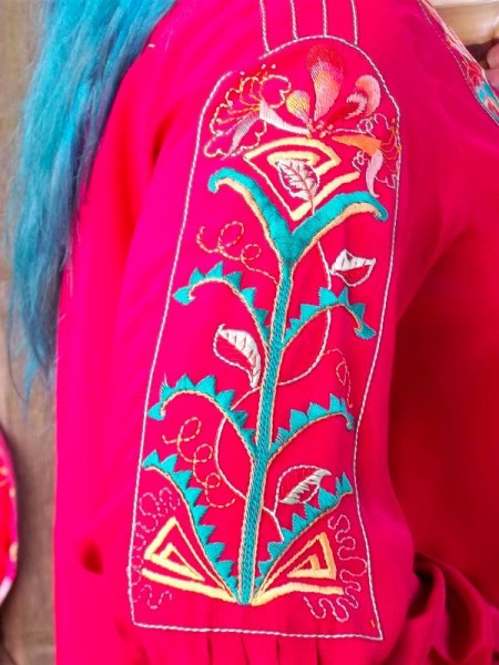 Lily and honeysuckle blouse showing embroidered sleeve panel and pleat detail. (Mary Addison)