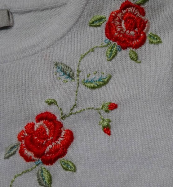 Rose embroidered cardigan: front detail (hand embroidered by Mary Addison)
