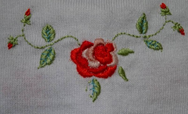 Rose hand-embroidered cardigan for a little girl (Mary Addison)