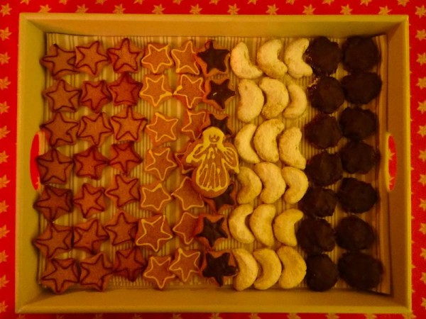 Tray of Christmas biscuits (gingerbread shapes, kipferl and lebkuchen) to have after Midnight Mass on Christmas Day