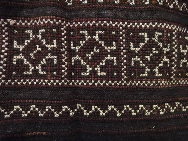 Traditional Vietnamese indigo dyed skirt with cross stitch embroidered panels