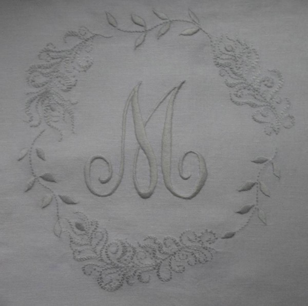 Cushion with monogram M, leaves and feathers (hand embroidered by Mary Addison)