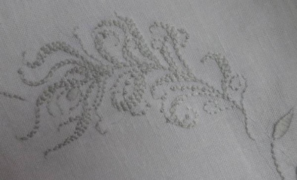 Embroidered feather/frond; hand embroidered on cushion with monogram M