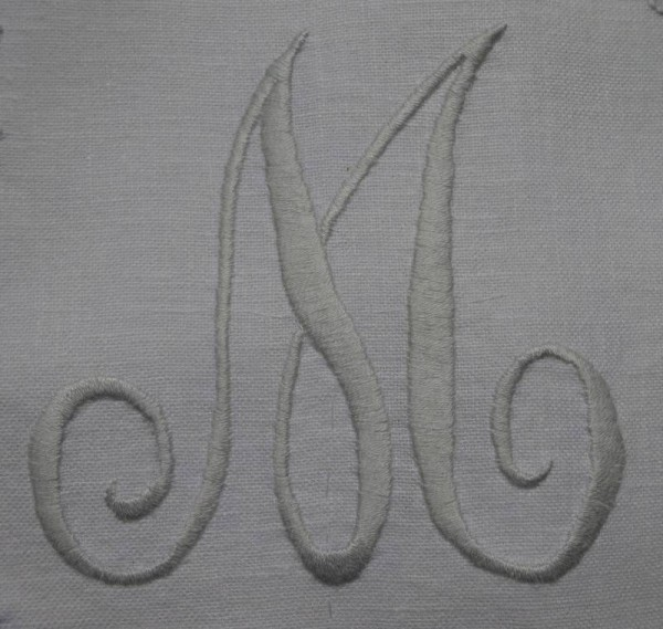 Hand embroidered  cushion: detail of  monogram M