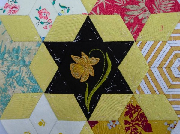 Ipsden Church, Oxon: patchwork altar frontal, detail of daffodil (hand embroidered by Mary