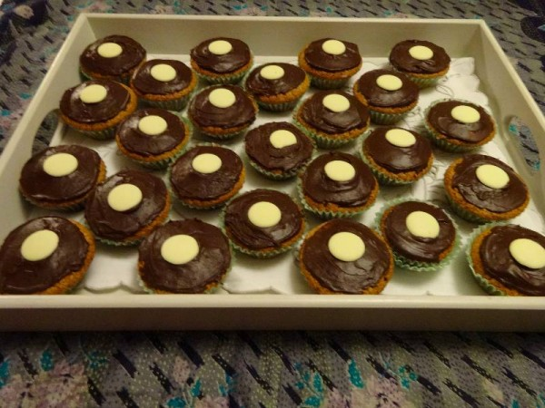 Milk chocolate cup cakes with chocolate fudge icing and white chocolate buttons