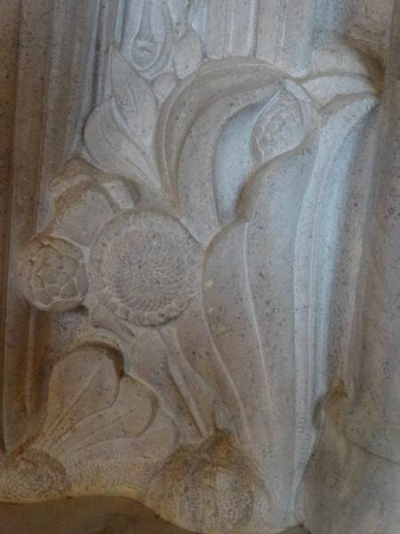 Rothbarth Memorial by Eric Kennington in Checkendon Church: detail showing sunflower.