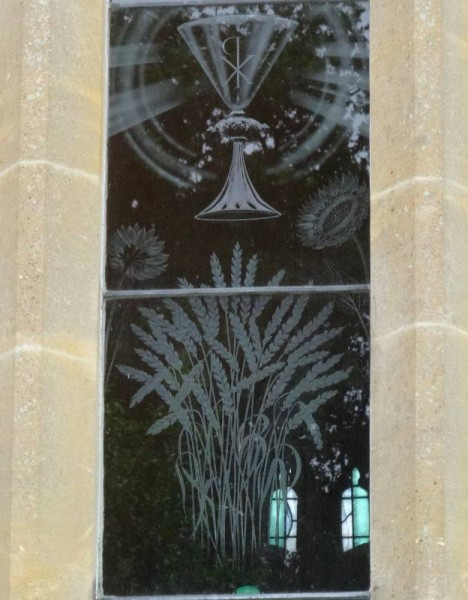 Checkendon church: Laurence Whistler engraved glass window commemorating Eric Kennington: detail showing wheatsheaf, sunflowers and  chalice