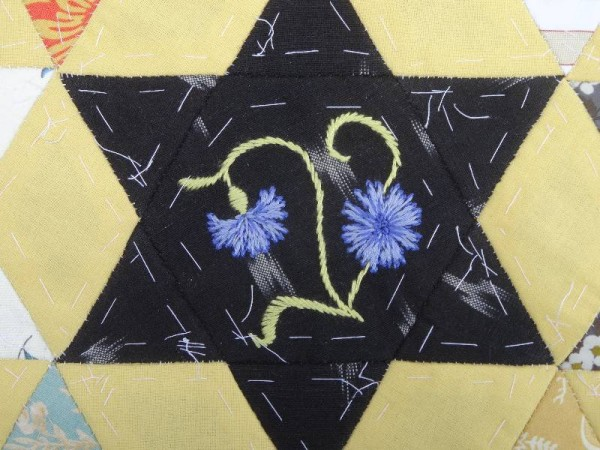 Ipsden Church, Oxon: patchwork altar frontal, detail of  cornflower (hand embroidered by Mary Addison)