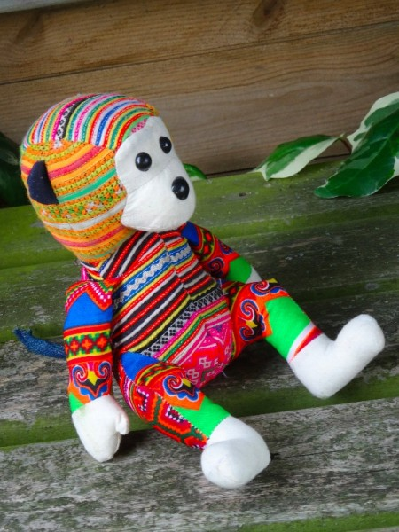 Hand crafted Vietnamese monkey made from modern fabric and vintage cross stitch embroidery.