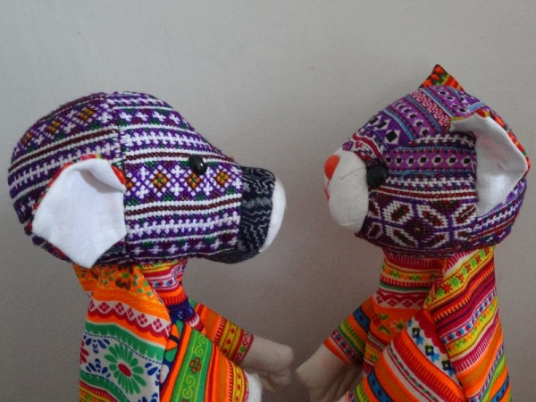 Vietnamese hand puppets made from vintage and new fabric: detail of hand embroidered heads