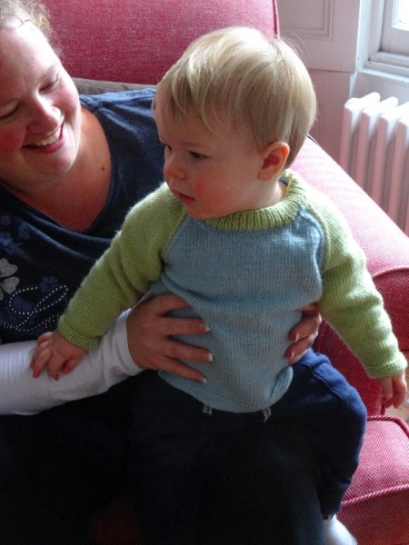 Nanny with baby wearing Debbie Bliss's design for a 2 colour raglan sweater