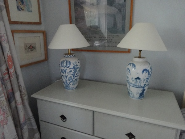 Isis Ceramics wigstand lamps.Tulip on the left and English Garden on the right.