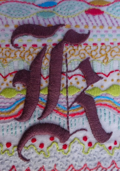 Gothic k in deep heather purple (hand embroidered by Mary Addison)