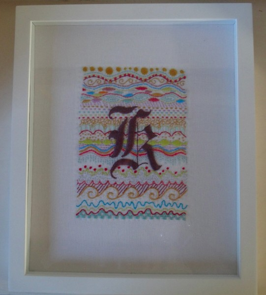 Framed Gothic k initial (hand embroidered by Mary Addison)
