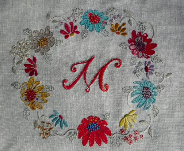 Monogram M with floral circlet (hand embroidered by Mary Addison)