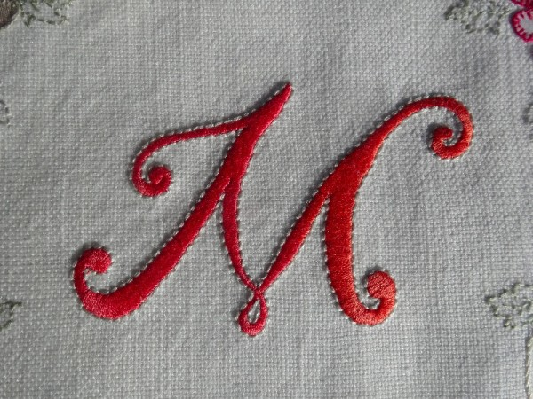 Hand embroidered M (by Mary Addison)