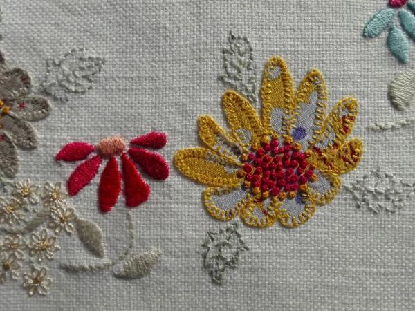 M monogram: detail of hand embroidered & appliquéd flowers