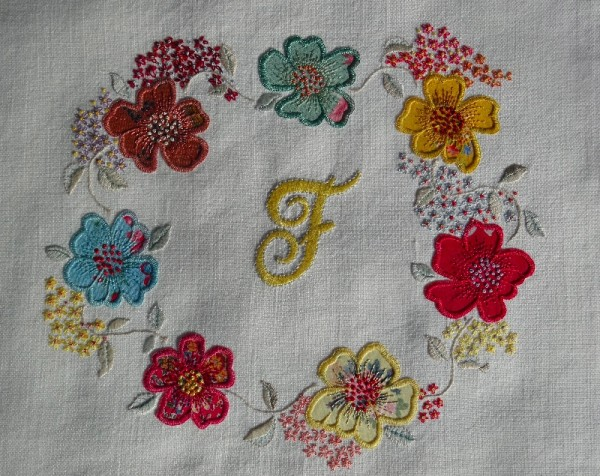 Monnogram F with floral circle (hand embroidered by Mary Addison)