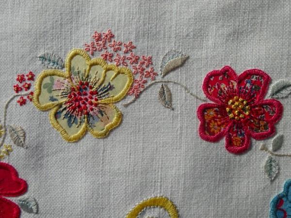 F monogram: detail of hand embroidered & appliquéd flowers