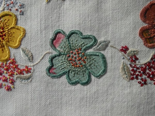 F monogram: detail of hand embroidered & appliquéd flowers