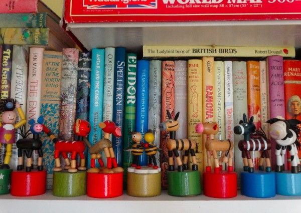A row of wooden dancing toys