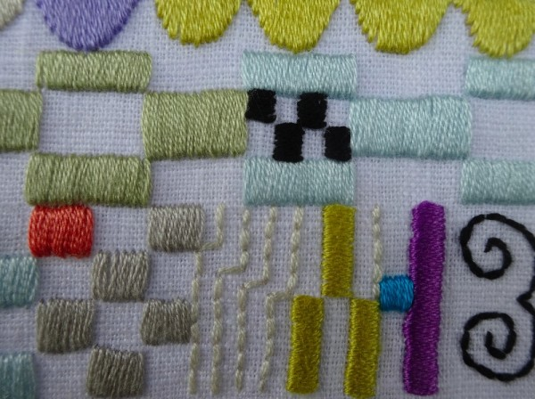 Building block monogram: a baptismal present for a baby boy: detail  (hand embroidered by Mary Addison)