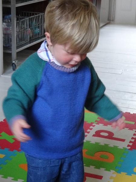 Little boy 10 months in Debbie Bliss pattern for 2 colour raglan jumper