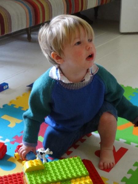 Little boy in Debbie Bliss pattern for 2 colour raglan jumper