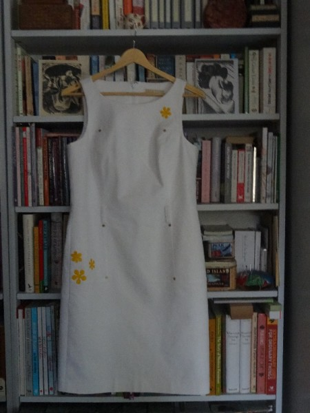 White Michael Kors dress  with lily stain covered by appliquéd silk daisies