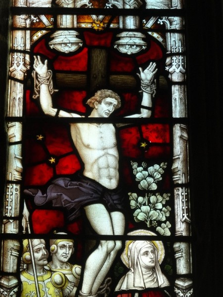 Ipsden Church: detail of east window showing one of the 2 robbers crucified along with Christ