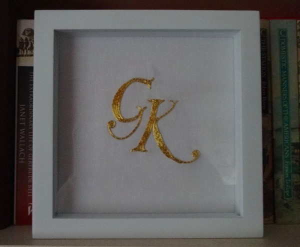 Framed GK monogram (hand embroidered by Mary Addison)